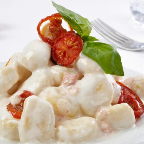 Chicche alla parmigiana con pomodori confit Atmospherae Catering Bologna